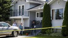 Calgary police investigators check out the home where five-year-old Nathan O'Brien and his grandparents Alvin and Kathryn Liknes disappeared, in Calgary, Alta., Wednesday, July 2, 2014. (Jeff McIntosh/The Canadian Press)