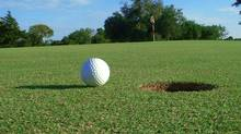 Golf ball on putting green