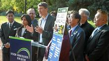 Mayor Gregor Robertson is surrounded by members of the Vision Vancouver team as they launch part of their 2011 election platform at Memerial South Park in Vancouver, October 23, 2011. (Jeff Vinnick/The Globe and Mail/Jeff Vinnick/The Globe and Mail)