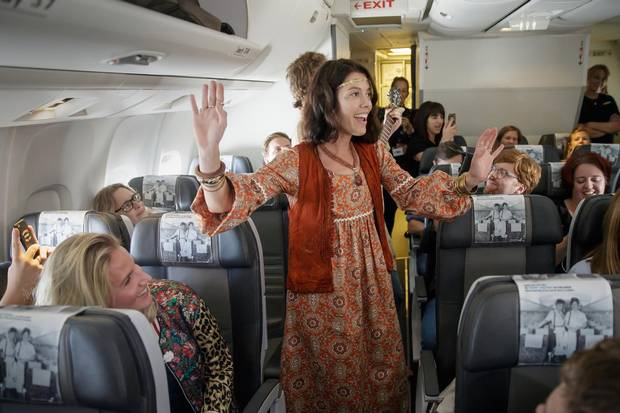 Icelandair staff and actors sing to passengers as they star in Ahead of Time, an immersive theatre production on a flight from London to New York in September.