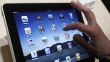 The Apple iPad, one of the many new e-readers coming onto the market. (AP)