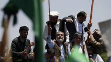 Afghan presidential candidate Abdullah Abdullah (C) attends a protest in Kabul June 27, 2014. (MOHAMMAD ISMAIL/REUTERS)