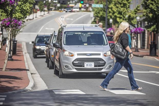 A Ford Transit approaches an intersection, part of a Virginia Tech study of how pedestrians will interact with autonomous vehicles.