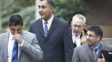 Aneal Basi (L), Dave Basi (centre left), his Lawyer Michael Bolton (centre right) and Bob Virk (R) leave BC Supreme Court October 18, 2010. (John Lehmann/The Globe and Mail/John Lehmann/The Globe and Mail)