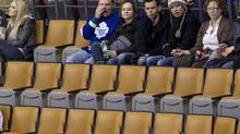 Toronto Maple Leafs fans react to the game as they sit amongst empty seats during the Maple Leafs 3-0 loss to Carolina Hurricanes in NHL action in Toronto on Tuesday March 27, 2012. (Chris Young/THE CANADIAN PRESS)
