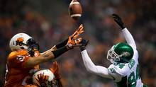 Saskatchewan Roughriders' Greg Carr, right, fails to make the catch as B.C. Lions' Korey Banks, left, and Ryan Phillips defend during the second half of a CFL football game in Vancouver, B.C., on Saturday November 3, 2012. (The Canadian Press)