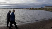 Prime Minister Stephen Harper, right, walks on the shore of the Beaufort Sea with Minister of Indian Affairs and Northern Development John Duncan while they visit Tuktoyaktuk, Northwest Territories on the fourth day of his five day northern tour to Canada's Arctic on Aug. 26, 2010. (Sean Kilpatrick/The Canadian Press/Sean Kilpatrick/The Canadian Press)