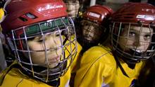 Phoenix Tashlin Clifford, 12, at left, has suffered four concussions. (Peter Power/The Globe and Mail/Peter Power/The Globe and Mail)