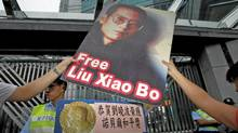 Protesters demonstrate outside the Chinese Foreign Ministry in Hong Kong on Oct. 8, 2010, demanding the release of jailed Chinese pro-democracy activist Liu Xiaobo. (BOBBY YIP/Bobby Yip/Reuters)