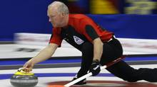 Ontario skip Glenn Howard delivers a stone during play against Alberta at the Brier curling championships in Halifax, Nova Scotia, March 11, 2010. REUTERS/Shaun Best (SHAUN BEST)