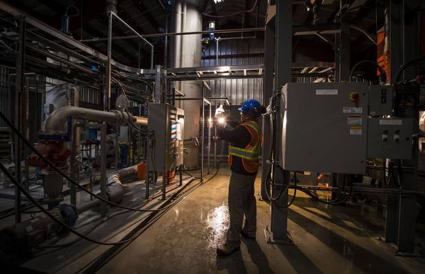 Project manager Scott Brundrett inside the demonstration plant in Squamish, B.C., that is developing a system to pull carbon out of the atmosphere.