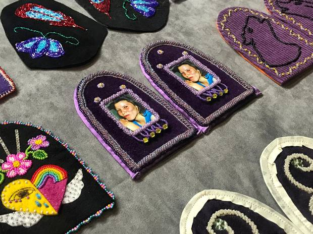 An image of Tiffany Morrison, whose remains were discovered four years after she went missing in June, 2006, is seen on a moccasin vamp. The vamp is part of an incomplete shoe, which symbolizes the lives that were lost.