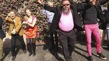 "Dissident Chinese artist Ai Weiwei (front) dances with his friends as they make a cover version of music video Gangnam Style by South Korean singer Psy at the courtyard of Ai's studio in Beijing in this October 24, 2012 file photo. Ai announced plans on March 11, 2013 to release a heavy-metal album that he said would ""express his opinion"" just as he does with his art. (HANDOUT/REUTERS)"