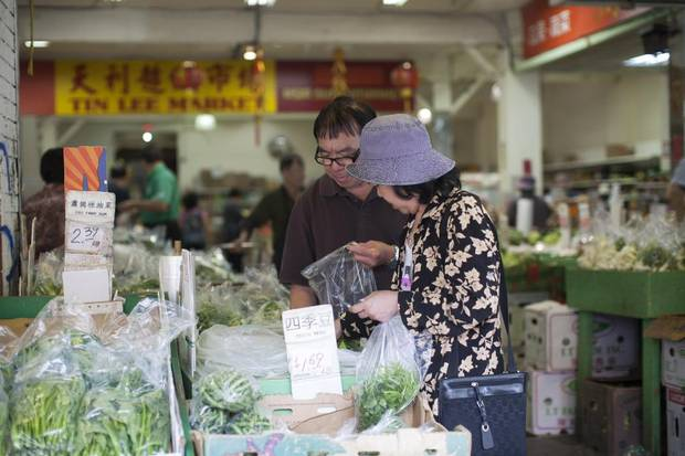 Shoppers at Tin Lee Market in Vancouver's Chinatown.