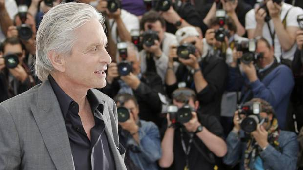 Actor Michael Douglas poses for photographers during a photo call for the film Behind the Candelabra at the 66th international film festival, in Cannes, southern France, Tuesday, May 21, 2013. (Francois Mori/The Associated Press)