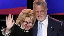 Quebec Liberal leader Philippe Couillard takes the stage with his wife, Suzanne Pilote, at his rally headquarters in St. Felicien, Que., April 7, 2014. (Mathieu Belanger/Reuters)