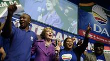 South African main opposition party Democratic Alliance (DA) leader Helen Zille (2nd L) dances with supporters on May 14, 2011 during her last rally before the May 18 municipal elections at the O.R. Tambo hall in Khayelitsha on the outskirts of Cape Town. South Africa heads to the polls for local elections on May 18 in a test of how long supporters of the juggernaut African National Congress are willing to wait for the promises of 1994 to be delivered. AFP PHOTO / RODGER BOSCH (Photo credit should read RODGER BOSCH/AFP/Getty Images) (RODGER BOSCH/AFP/Getty Images)