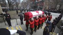 The casket of Canada's former finance minister, Jim Flaherty, arrives at St. James Cathedral for his state funeral in Toronto on Wednesday, April 16, 2014. (FRED THORNHILL/REUTERS)