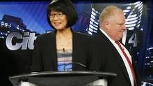 Toronto Mayor Rob Ford walks past candidate Olivia Chow (L), pauses before a Toronto Mayoral election debate in Toronto, March 26, 2014. (MARK BLINCH/REUTERS)