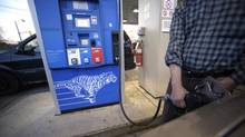 Motorists pump gas at a gasoline station in Toronto in this file photo. (Fred Lum/Fred Lum/The Globe and Mail)