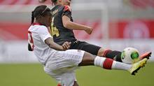 Canada's Kadeisha Buchanan, left, and Germany's Dzsenifer Marozsan challenge for the ball during the international friendly women's soccer match between Germany and Canada in Paderborn, Germany, Wednesday, June 19, 2013. (Martin Meissner/AP)