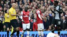 Arsenal's Jack Wilshere (3rd L) argues with Tottenham Hotspur's Emmanuel Adebayor (R) as Santi Garzola lies on the ground during their English Premier League match at the Emirates stadium in London November 17, 2012. Adebayor was sent off for the foul. (DYLAN MARTINEZ/Reuters)