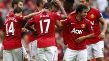 Manchester United's Nick Powell celebrates his goal against Wigan Athletic with teammates Sept. 15, 2012. (DARREN STAPLES/REUTERS)