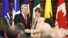 Canada's Prime Minister Stephen Harper (L) shakes hands with Government Leader in the Senate Marjory LeBreton after delivering a speech during a Conservative caucus meeting on Parliament Hill in Ottawa on May 21, 2013. Ms. LeBreton announced July 4, 2013 that she would resign from Canada's scandal-tinged Conservative government, but gave no reasons. (CHRIS WATTIE/REUTERS)