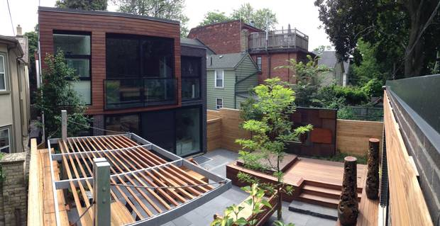 Homeowners are looking for architectural elements to make the garage part of the outdoor space, such as this Cabbagetown backyard.
