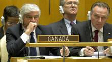 Foreign Affairs Minister Lawrence Cannon and junior minister Peter Kent react after Canada was forced into a run-off vote against Portugal at United Nations headquarters in New York on Oct. 12, 2010. (DON EMMERT/AFP/Getty Images)