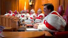 Justice Richard Wagner, right, delivers a speech as his fellow judges take part in his welcoming ceremony at the Supreme Court of Canada in Ottawa on Monday, December 3, 2012 (Blair Gable/The Canadian Press)