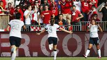 Sydney Leroux of the U.S. celebrates her goal with teammate Heather O'Reilly during the second half of their friendly women's soccer match against Canada in Toronto, June 2, 2013. (MARK BLINCH/REUTERS)