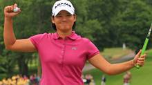 Yani Tseng of Taiwan celebrates her ten stroke victory on the 18th hole during the final round of the Wegmans LPGA Championship at Locust Hill Country Club on June 26, 2011 in Pittsford, New York. (Photo by Hunter Martin/Getty Images) (Hunter Martin/Getty Images)