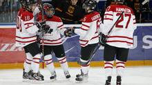 Canada's Jonathan Drouin (C) celebrates his goal with teammates Brett Ritchie (L), Ryan Strome (2nd L), Scott Harrington (2nd R), and Dougie Hamilton against Germany in the first period of their preliminary round game during the 2013 IIHF U20 World Junior Hockey Championship in Ufa, December 26, 2012. (MARK BLINCH/REUTERS)