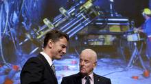 Barrick Gold chairman Peter Munk (right) chats with company president and CEO Aaron Regent during their annual general meeting in Toronto on Wednesday May 2, 2012 (Chris Young/THE CANADIAN PRESS)
