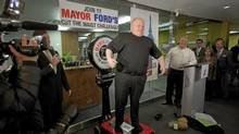 Toronto Mayor Rob Ford jokes around while standing on a scale during a weigh in marking the start of a 6 month weight loss challenge that Ford and his brother Doug are attempting in Toronto on Monday, Jan. 16, 2012. (Pawel Dwulit/Pawel Dwulit for The Globe and Mail)