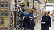 Employees of Rona at Dix30 in Brossard, Quebec on April 8, 2008. (Christinne Muschi for The Globe and Mail)