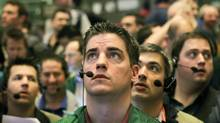 CME traders watch prices after the Federal Reserve announcement March 15, 2011 (Scott Olson/2011 Getty Images)