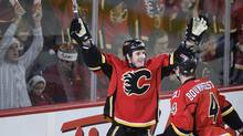 Calgary Flames' Curtis Glencross celebrates a goal with Jay Bouwmeester against the Detroit Red Wings during the 1st period of their NHL hockey game in Calgary, Alberta, December 22, 2011. (STRINGER/CANADA/REUTERS)
