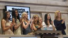Sports Illustrated swimsuit models ring the closing bell at the New York Stock Exchange, Feb. 11, 2013. The magazine's annual swimsuit issue hits newsstands this week. (BRENDAN MCDERMID/REUTERS)