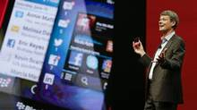 Thorsten Heins, CEO at BlackBerry, holds up a BlackBerry 10 mobile device in this file photo. (John Raoux/AP Photo)