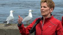 Ontario Premier Kathleen Wynne makes an election stop on the edge of the Ottawa River in Ottawa on Thursday, May 8, 2014. Ontario voters go to the polls on June 12. (Sean Kilpatrick/THE CANADIAN PRESS)