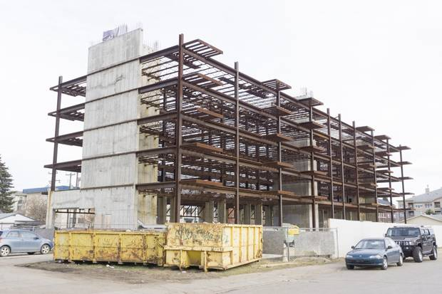 A condo under construction sits vacant in downtown Fort McMurray. Business is slow.
