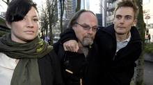 Karl Lilgert, centre, is seen leaving at the B.C. Supreme Court with family members in downtown Vancouver, B.C., Thursday, January, 17, 2013. Lilgert is accused of causing death after two passengers died when the Queen of the North ferry sank. (JONATHAN HAYWARD/THE CANADIAN PRESS)
