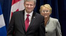 "Prime Minister Stephen Harper, left, and Quebec Premier Pauline Marois walk in to participate at an announcement Friday, February 1, 2013 in Lévis Que. Mr. Harper has categorically rejected Quebec's demands for changes to tough new employment insurance rules that Premier Pauline Marois says will have ""dramatic consequences"" on seasonal workers in her province. (Jacques Boissinot/The Canadian Press)"
