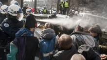 Police use pepper spray to disperse a crowd blocking the Delta hotel during a demonstration against higher tuition fees Thursday, February 16, 2012 in Montreal. (Ryan Remiorz/THE CANADIAN PRESS/Ryan Remiorz/THE CANADIAN PRESS)