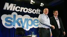 Microsoft CEO Steve Ballmer, left, shakes hands with Skype CEO Tony Bates during a news conference on May 10, 2011 in San Francisco. Microsoft has agreed to buy Skype for $8.5-billion (U.S.) (Justin Sullivan/JUSTIN SULLIVAN/GETTY IMAGES)