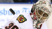 Chicago Blackhawks goalie Ray Emery keeps his eyes on a shot by the Tampa Bay Lightning during the second period of an NHL hockey game on Friday, Nov. 4, 2011, in Tampa, Fla. (AP Photo/Chris O'Meara) (Chris O'Meara/AP)
