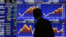 A man looks at a stock quotation board outside a Tokyo brokerage Monday, Oct. 7, 2013 (Toru Hanai/Reuters)