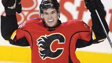 Calgary Flames' Sean Monahan celebrates scoring the winning goal against the New Jersey Devils during third period NHL action in Calgary, Alta., Friday, October 11, 2013. (Larry MacDougal/THE CANADIAN PRESS)